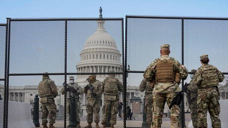 Top Iranian commander mocks Washington as US armed forces on alert for American attackers during Biden's inauguration