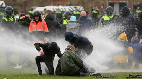 Woman knocked over & left bleeding after water cannon fires from close range during anti-lockdown protests in Netherlands (VIDEO)