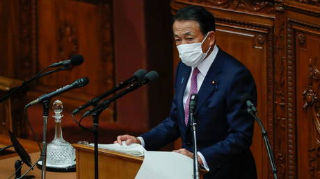 Japanese PM apologizes after ruling coalition lawmakers visit nightclub in violation of Covid-19 restrictions
