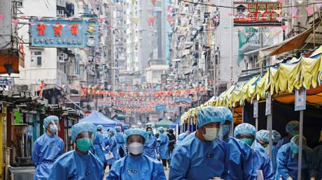 Hong Kong resorts to 'ambush lockdowns' to fight virus outbreaks in high-density housing