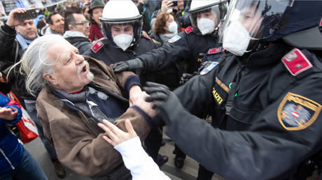 Clashes, arrests as thousands face off with riot police at protest against Covid-19 lockdown in Vienna