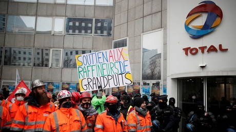 French refinery workers and climate protesters clash with police outside office of oil giant