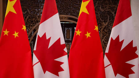 China urges Canada to end 'Cold War mentality & stop unprovoked smear attacks' after it claims Beijing is national security threat