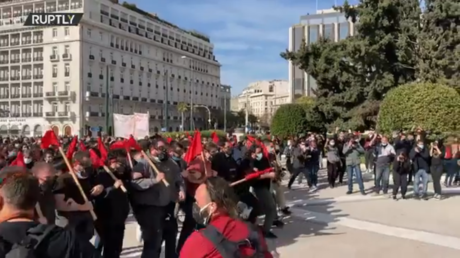 Youths hurl FIREBOMBS at riot police in Athens as Greece debates controversial education reforms (VIDEO)