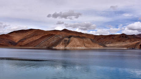 India & China begin to pull troops back from contested Himalayan lake, India's defense minister confirms