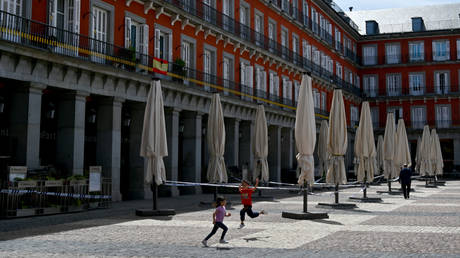 Spain begins to ease Covid lockdown, but says border with Portugal will be sealed for at least 2 more weeks