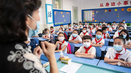 China's class action: Beijing bans teachers from using harsh physical and mental punishments to discipline schoolchildren