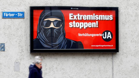 """Swiss voters support """"burqa ban"""" that outlaws wearing of facial coverings in public places"""