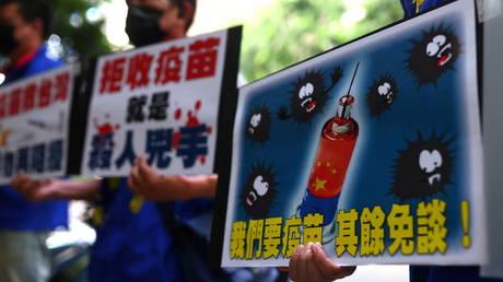 China urges Taiwanese to get Covid-19 shots on mainland as island struggles with coronavirus spike