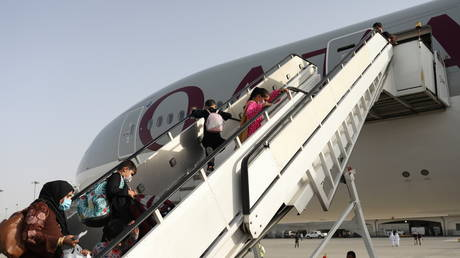 White House pauses Afghan flights to US after 4 evacuees test positive for MEASLES