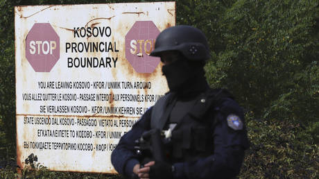 Kosovo's Albanian police ban Serbian license plates, use tear gas against protesters, as US and EU urge 'restraint' on both sides