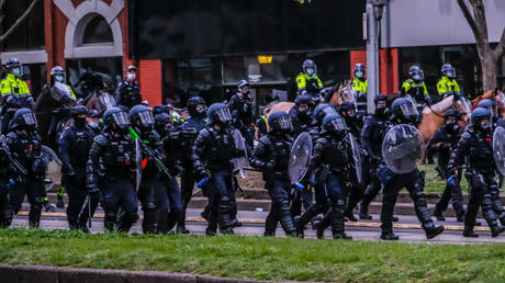 Australian police attempt to keep reporters from covering Covid-19 protests, back off after news outlet threatens legal challenge