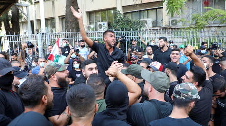 Heavy gunfire in Beirut kills 2 as violent protests against Beirut blast judge sweep capital, with Lebanese army deployed