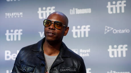 Netflix defends Chappelle comedy special from protests as employees plan walkout over 'transphobic' jokes