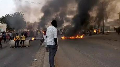 Sudan facing full military coup, Information Ministry warns, as military arrest prime minister, raid radio and TV stations